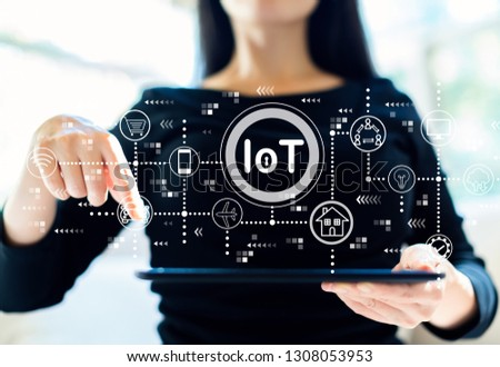 IoT theme with woman using her tablet #1308053953