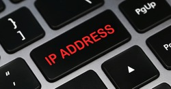 IP ADDRESS word on a keyboard. Programming and IT concept.