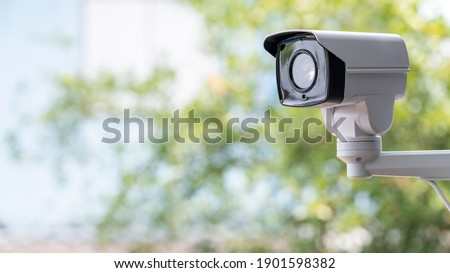 IP CCTV camera install by have water proof cover to protect camera with home security system concept with blur background. Foto stock ©