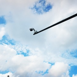 IP CCTV camera installs by having waterproof cover to protect the camera with road security system concept. CCTV street cameras on a pole