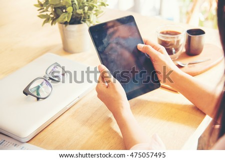 Ipad holding by working woman person. Lifestyle with modern woman using tablet or Ipad with hand holding touchscreen. Hands of working woman with Smart Tablet reading online website . Business Concept