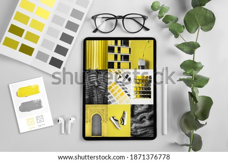iPad pro on the table on screen Collage Illuminating and Ultimate gray Pantone color of the year 2021