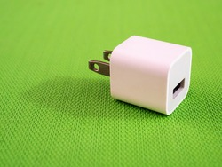 Iphone charge on green background