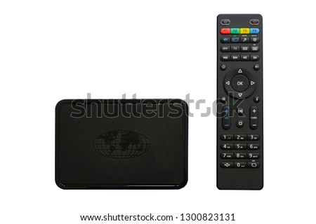 Iptv box and remote controller. Modern multimedia device for viewing television via the Internet, multimedia player and control panel. Isolated, white background.