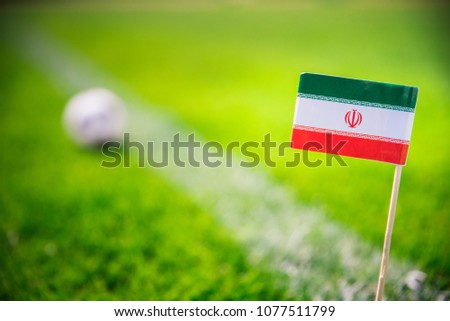 IR IRAN national Flag and football ball on green grass. Fans, support photo, edit space.  #1077511799