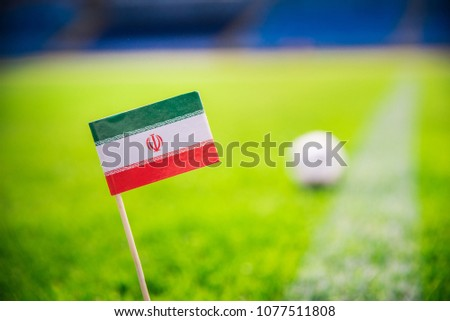IR IRAN national Flag and football ball on green grass. Fans, support photo, edit space.  #1077511808