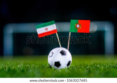 IR Iran - Portugal, Group B, Monday, 25. June, Football, National Flags on green grass, white football ball on ground. #1063027685