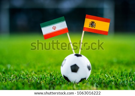 IR Iran - Spain, Group B, Wednesday, 20. June, Football, World Cup, Russia 2018, National Flags on green grass, white football ball on ground. #1063016222