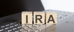 IRA abbreviation stands for written on wooden cube on laptop