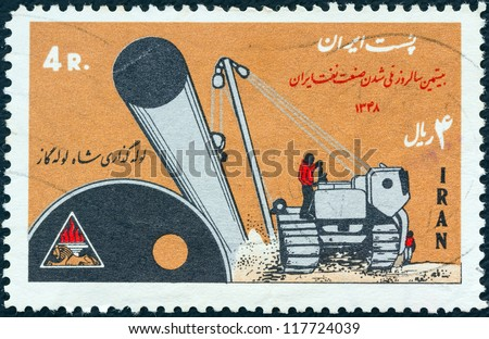 IRAN - CIRCA 1970: A stamp printed in Iran shows laying of gas pipe line and tractor, circa 1970.