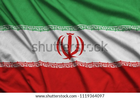 Iran flag  is depicted on a sports cloth fabric with many folds. Sport team banner #1119364097