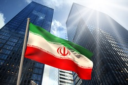 Iran national flag against low angle view of skyscrapers