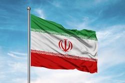 Iran national flag cloth fabric waving on beautiful sky.