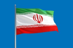 Iran national flag waving in the wind on a deep blue sky. High quality fabric. International relations concept.
