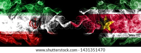 Iran vs Suriname, Surinamese smoky mystic states flags placed side by side. Thick colored silky smokes flag combination of Iranian and Suriname, Surinamese #1431351470