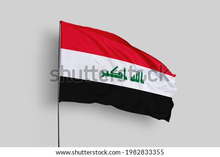 iraq flag isolated on white background. close up waving flag of iraq. flag symbols of iraq.