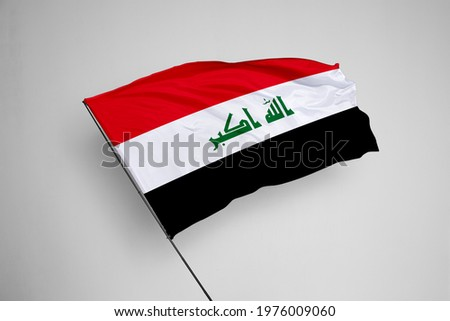 Iraq flag isolated on white background with clipping path. close up waving flag of Iraq. flag symbols of Iraq. Iraq flag frame with empty space for your text.