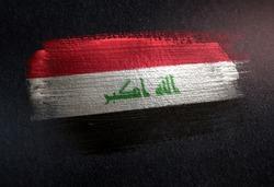 Iraq Flag Made of Metallic Brush Paint on Grunge Dark Wall