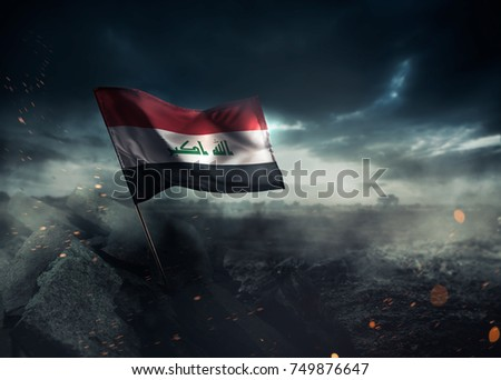 Iraq flag waving with hope after a disaster. / high contrast image