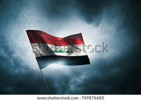 Iraq flag waving with pride on a cloudy day / high contrast image