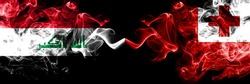 Iraq, Iraqi vs Tonga, Tongan smoky mystic flags placed side by side. Thick colored silky smokes flags together