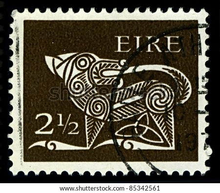 "IRELAND-CIRCA 1971: A stamp printed in IRELAND shows image of ""Dog"" part of an old Irish decorative brooch, circa 1971."