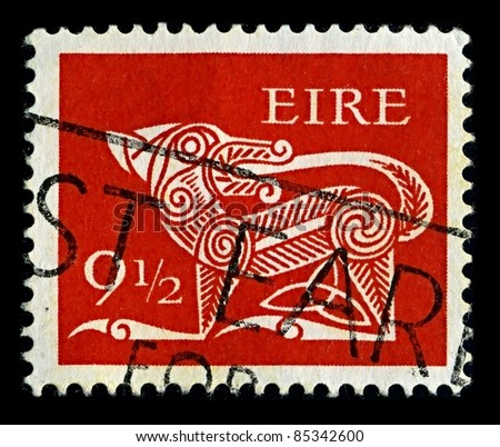 "IRELAND-CIRCA 1979: A stamp printed in IRELAND shows image of ""Dog"" part of an old Irish decorative brooch, circa 1979."