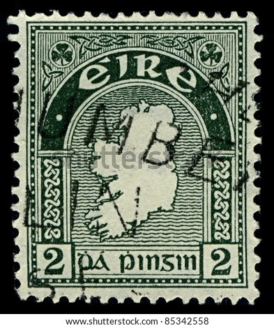 "IRELAND-CIRCA 1922: A stamp printed in IRELAND shows image of National symbols Ireland ""Map"", circa 1922. - stock photo"