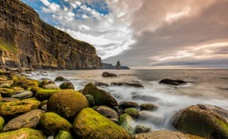 Ireland countryside tourist attraction in County Clare. The Cliffs of Moher and castle Ireland. Epic Irish Landscape UNESCO Global Geopark the wild atlantic way. Beautiful scenic nature hdr Ireland.