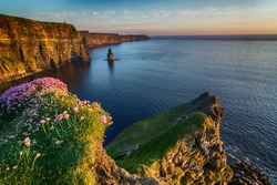 Ireland countryside tourist attraction in County Clare. The Cliffs of Moher and castle Ireland. Epic Irish Landscape Seascape along the wild atlantic way. Beautiful scenic nature hdr Ireland.