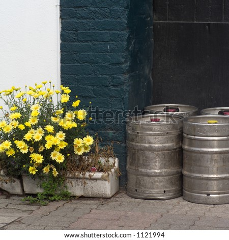 Ireland - Kinsale - kegs outside building with yellow flowers