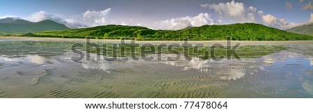 Ireland landscape with clouds mountains sea the ocean and the beach