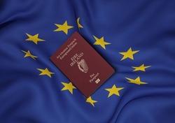 Ireland passport with European Union flag in background