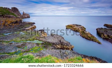 Ireland's Eye is an island on the East coast of Ireland near Howth as seen from Burrow Beach of Sutton, Dublin Stock fotó ©