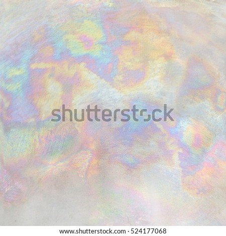Shutterstock Iridescent metallic texture.