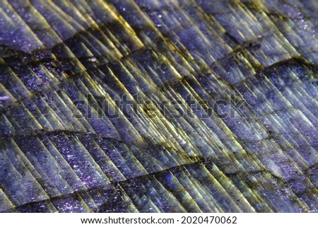 Irisation under the surface of labradorite. Irisation is an optical effect, an iridescent glow with a different color spectrum. Photo stock ©