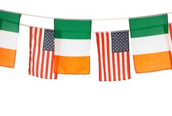 Irish and american banner flags on white background, st Patrick holiday. Studio shot.