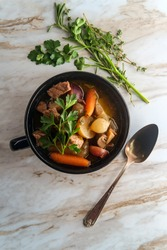 Irish beef stew with multicolored new potatoes carrots and mushrooms