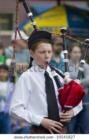 Irish Boy playing Bagpipes St. Patrick's Day Parade