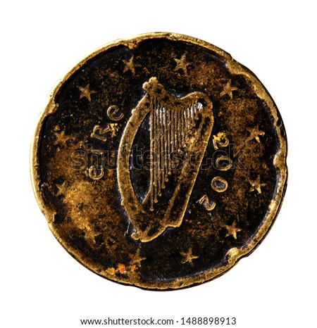 Irish 20 cent Euro coin old and worn with harp emblem, close up. Wear, grime and damage clearly visible. Isolated.  #1488898913