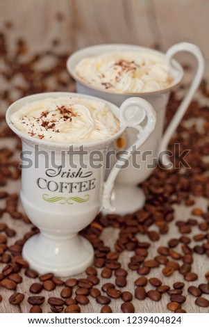 Irish Coffee, a delicious coffee speciality with whipped cream in an extravagant cup #1239404824