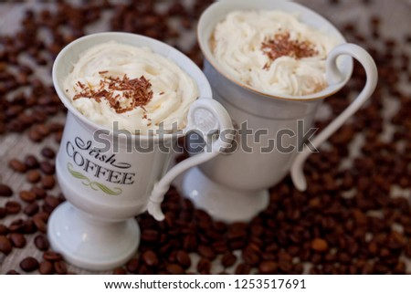 Irish Coffee, a delicious coffee speciality with whipped cream in an extravagant cup #1253517691