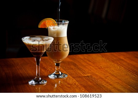 Irish coffee and coffee cocktail served on bar table