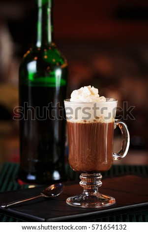 Irish coffee in a bar. Concept of St Patrick holiday. Holiday background. Irish national day. Warm tone. Vertical