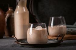 Irish cream coffee liqueur with ice on dark background