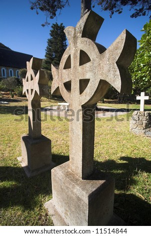 Irish Cross shaped old headstone of a grave made from granite