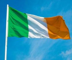 Irish flag over a blue sky background