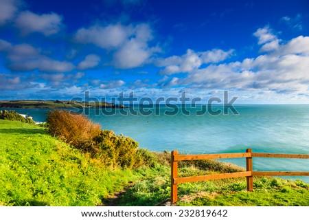 Irish landscape. Coastline atlantic ocean coast scenery cloudy blue sky, Church Bay County Cork, Ireland Europe