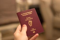 irish passport held in hand