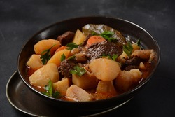 Irish stew made with beef, potatoes, carrots and herbs. Traditional St.Patrick's day dish, stewed in dark Guinness beer